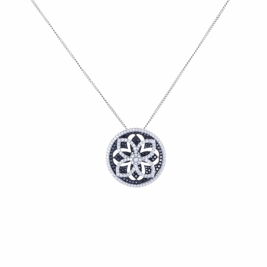 spring loaded white and black diamond pendant in 18ct white gold